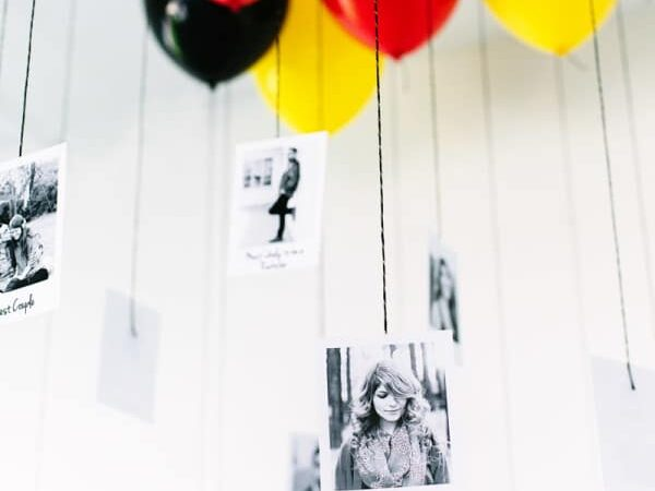 Hanging Polaroid photos at the end of balloon strings makes for a memorable birthday party idea | The Dating Divas