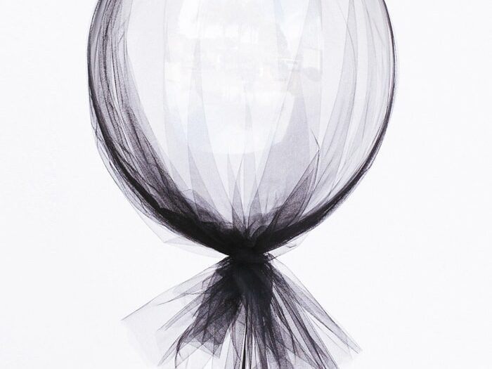 Tie tulle around balloons for elegant and classy birthday decorations | The Dating Divas