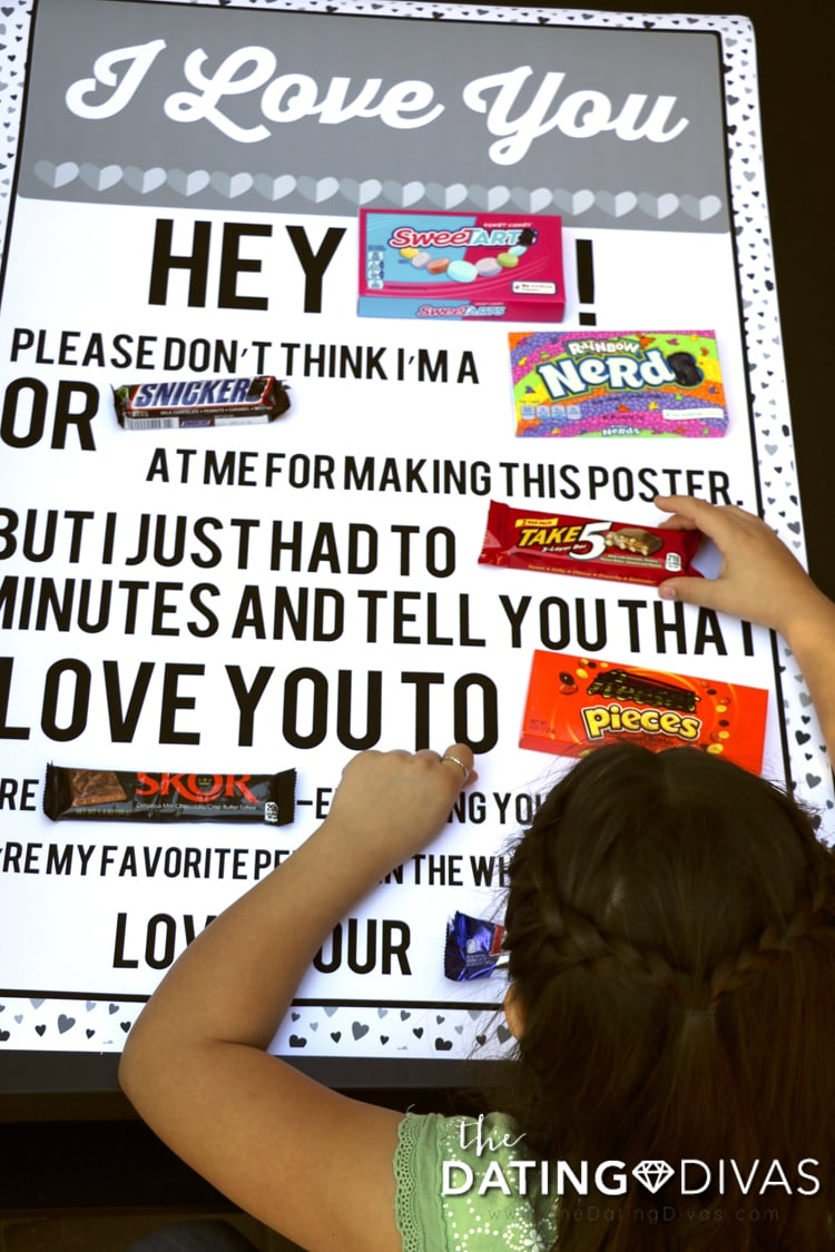 girl making a DIY Candy Gram Poster