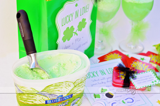 Tub of green ice cream with black handled ice cream scoop