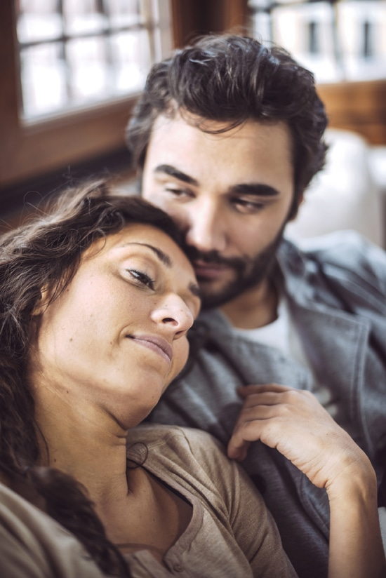 Wife leaning her head on her husbands shoulder after learning to trust again