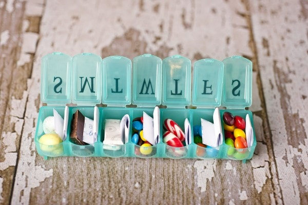 Notes in a pill box for when parents are away