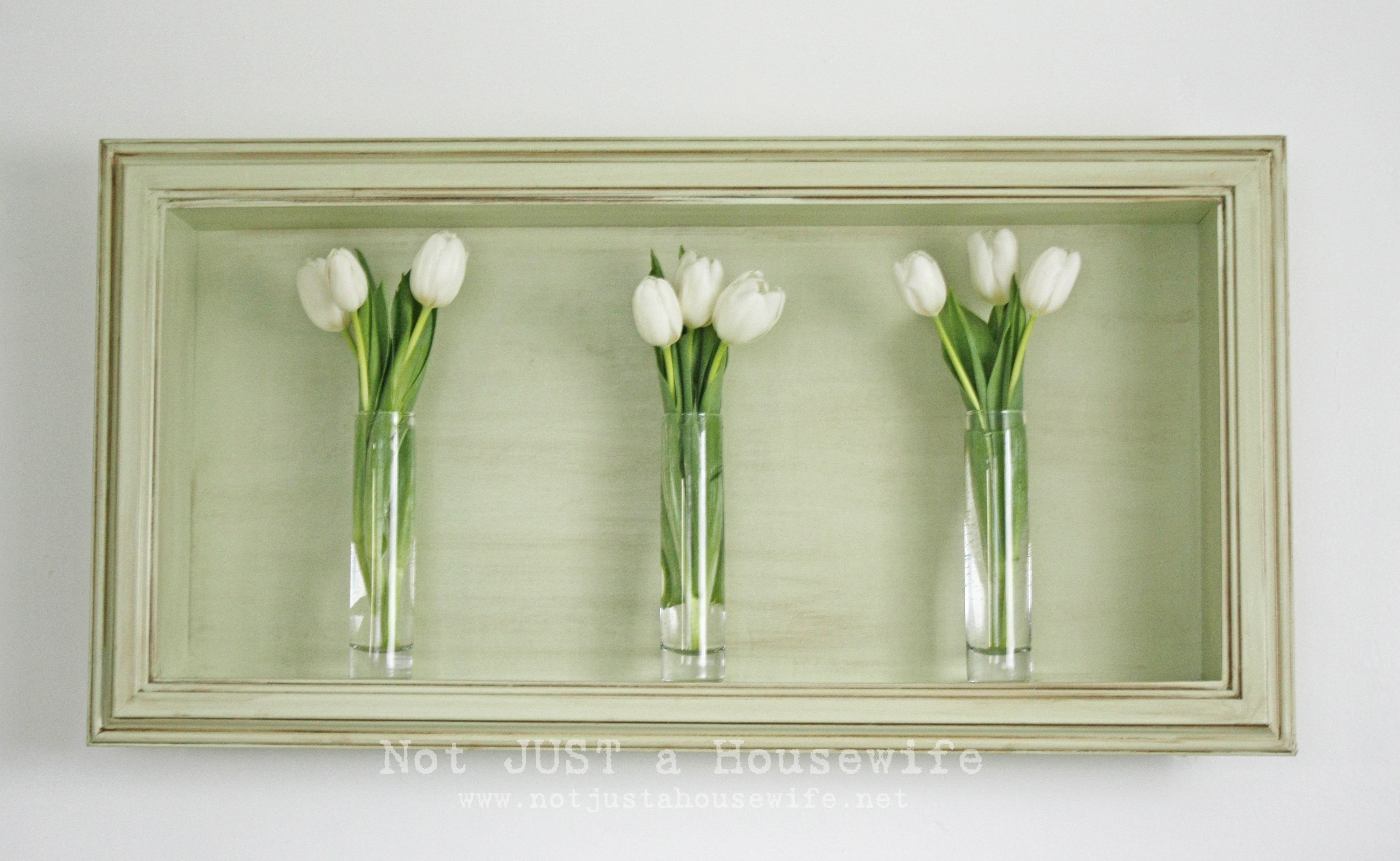 Shadow box of tulips in master bedroom